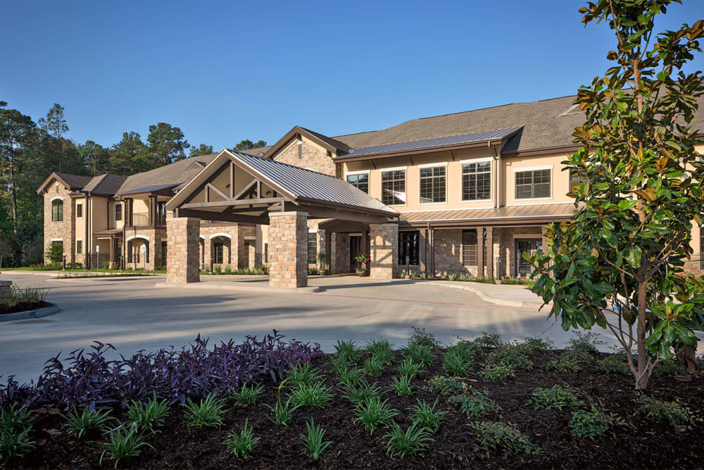 The driveway and building exterior of Spring Creek Village in Spring, Texas