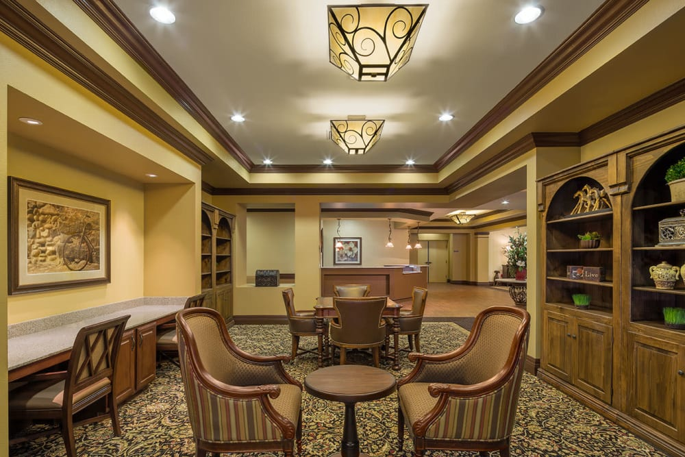 Community seating in a resident lounge at Spring Creek Village in Spring, Texas