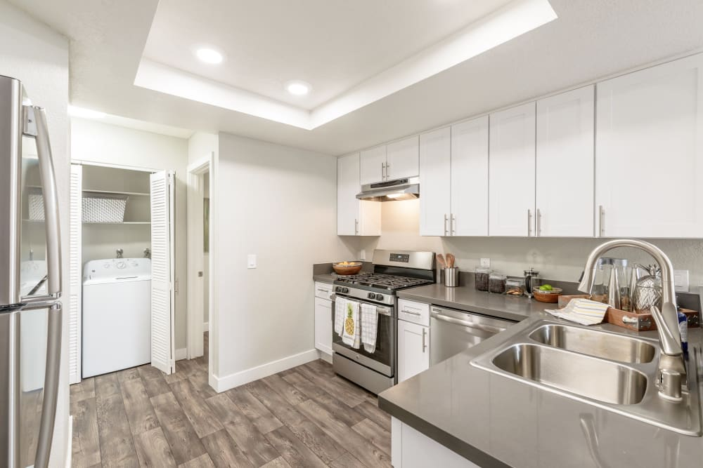 Bright kitchen with stainless steel appliances at Sonora at Alta Loma in Alta Loma, California