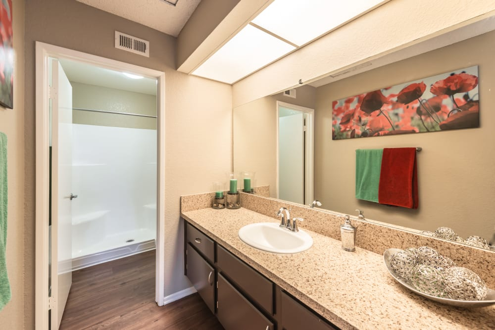 Bathroom model with red and green towels at Sonora at Alta Loma in Alta Loma, California