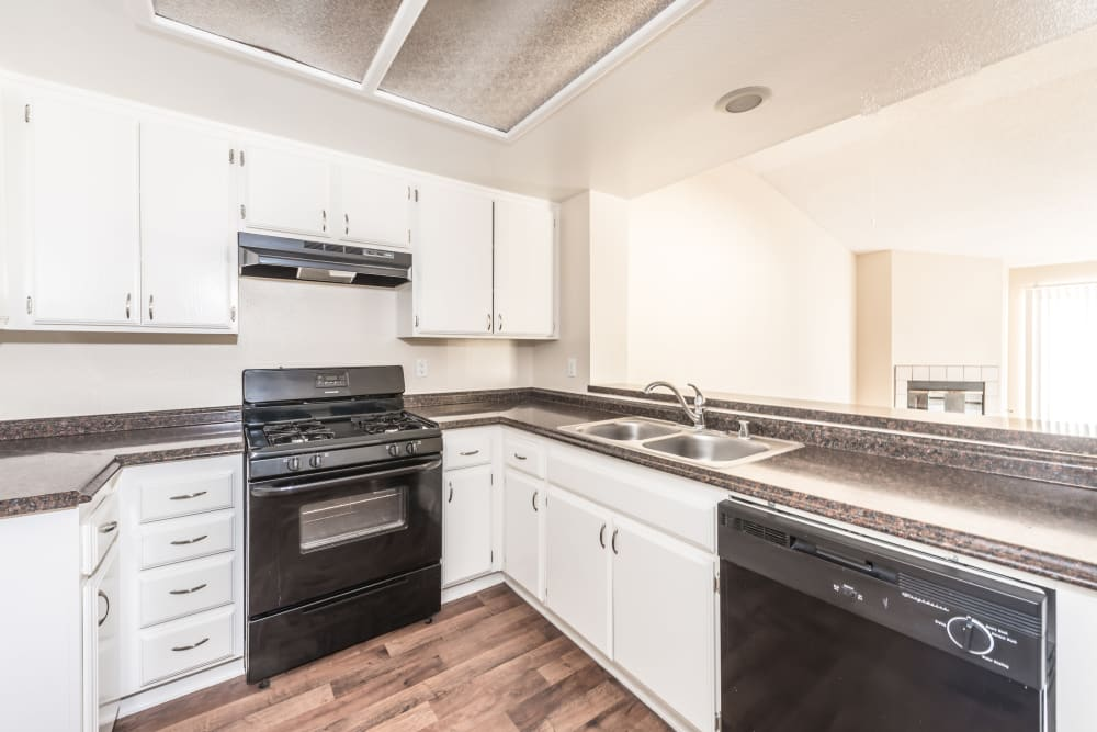 Kitchen with black appliances at Sonora at Alta Loma in Alta Loma, California