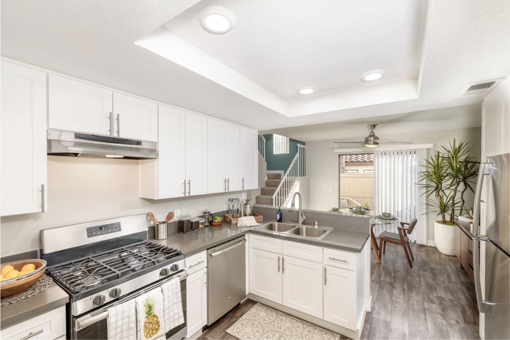 Kitchen and dining space at Sonora at Alta Loma in Alta Loma, California