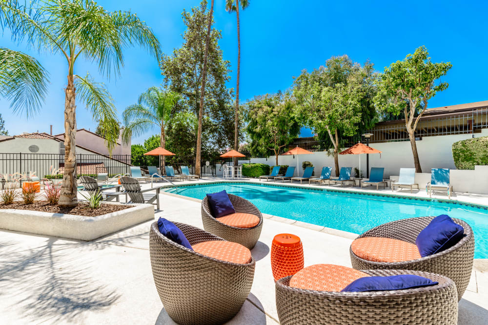 Patio chairs by the pool at Sonora at Alta Loma in Alta Loma, California