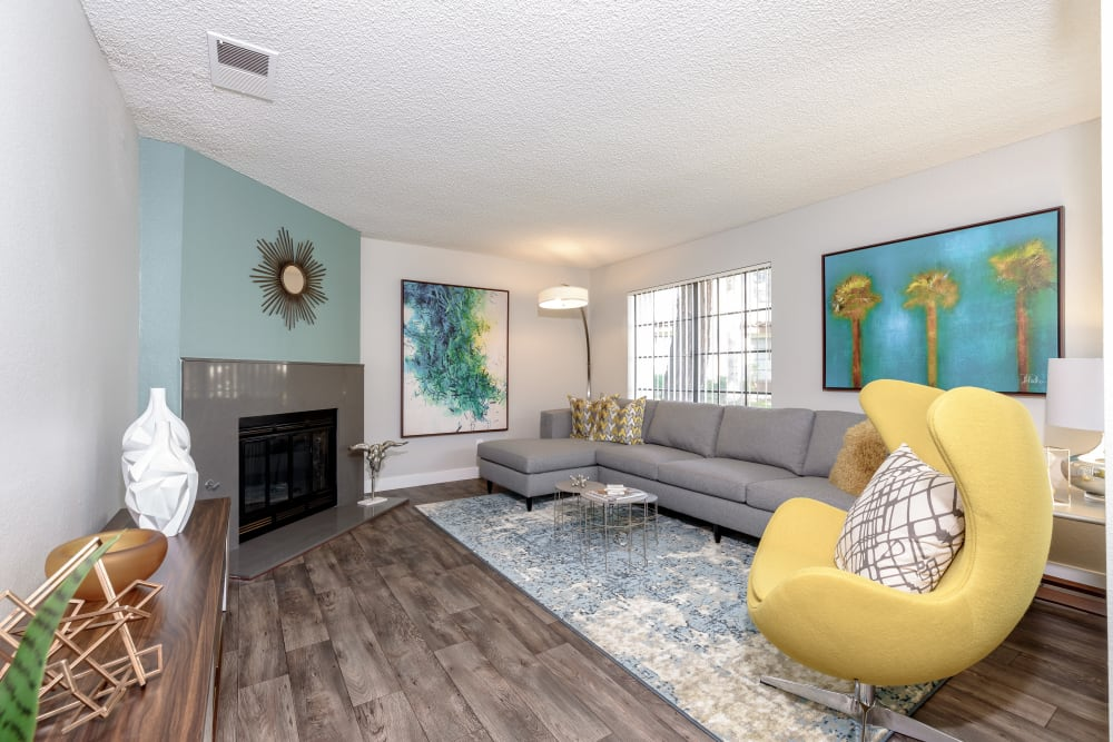 Living room model with blue walls at Sonora at Alta Loma in Alta Loma, California
