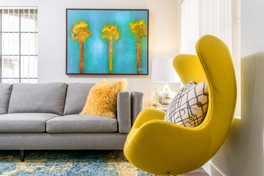 Yellow chair in living room at Sonora at Alta Loma in Alta Loma, California