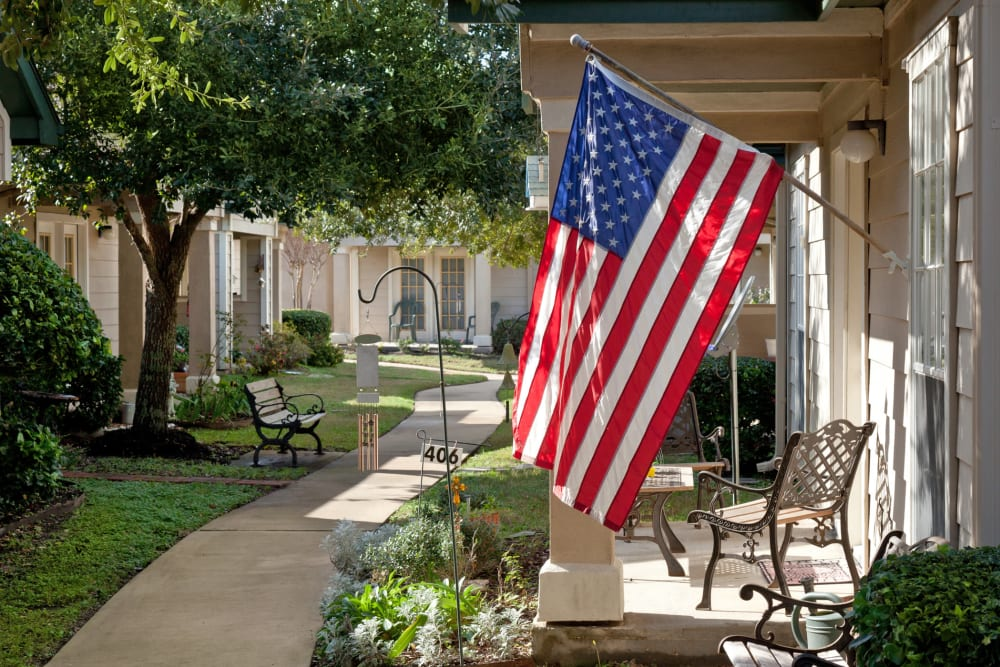 Senior apartment exteriors at Carriage Inn Huntsville in Huntsville, Texas