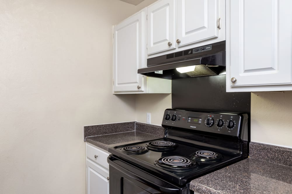 Kitchen with black stove at Carriage Hills in Macon, Georgia