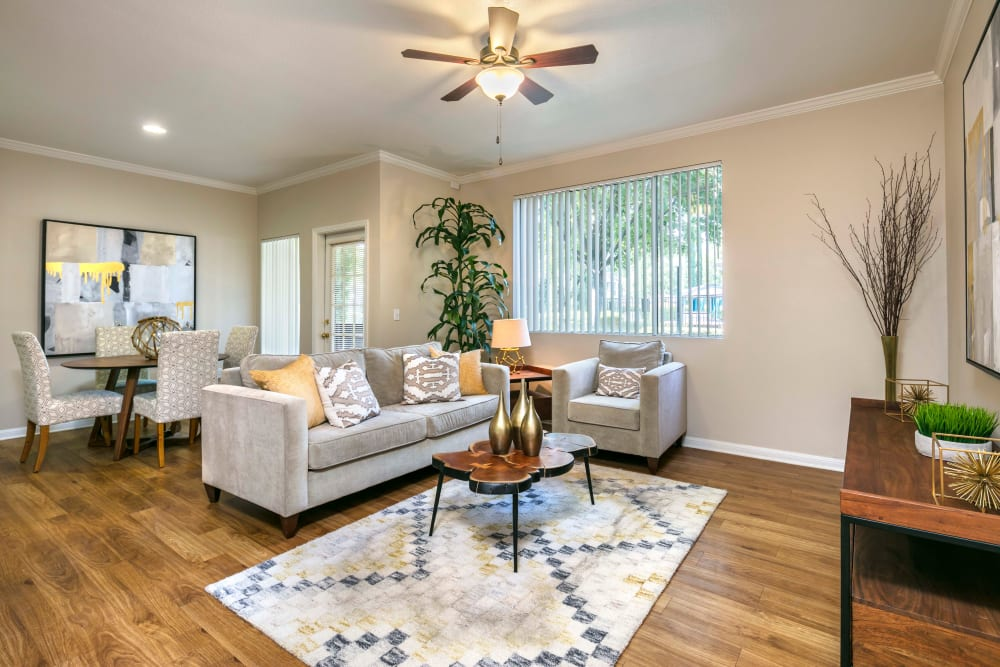 A spacious living room with hard wood floors at Miramonte and Trovas in Sacramento, California