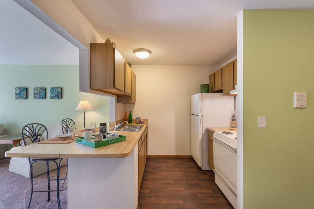 White appliances in the kitchen at Kellogg Cove Apartments in Kentwood, Michigan