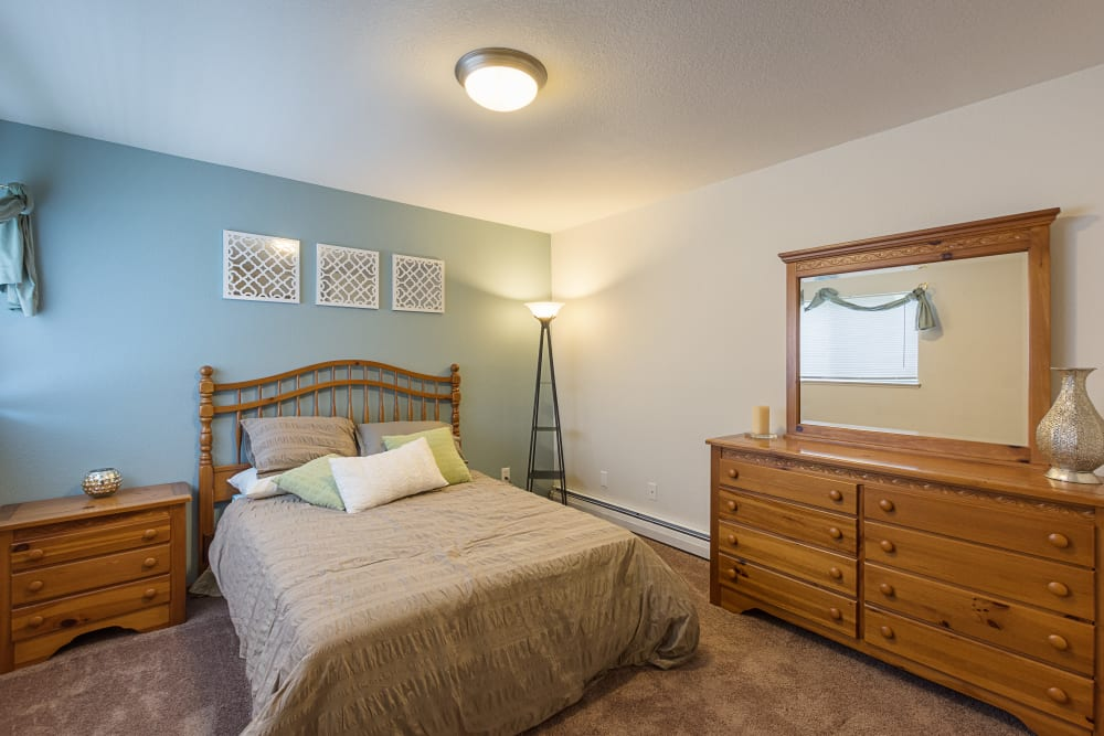 Master bedroom in model home at Kellogg Cove Apartments in Kentwood, Michigan