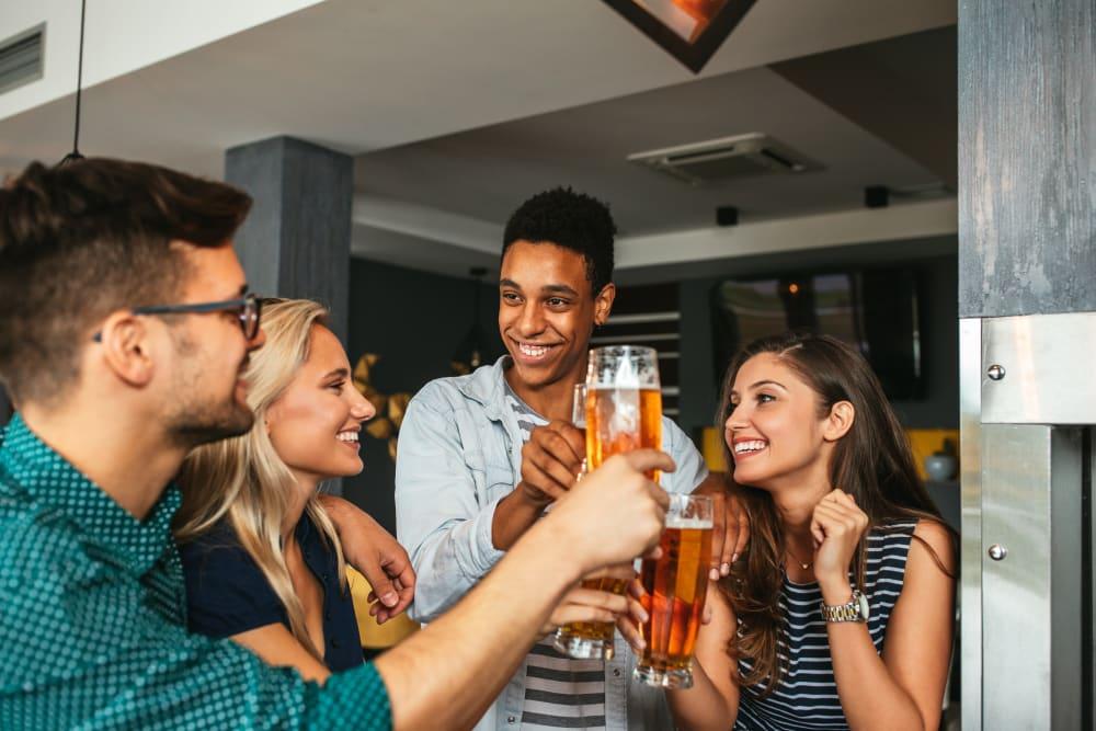 Friends enjoying drinks together in Colorado Springs, Colorado near FalconView