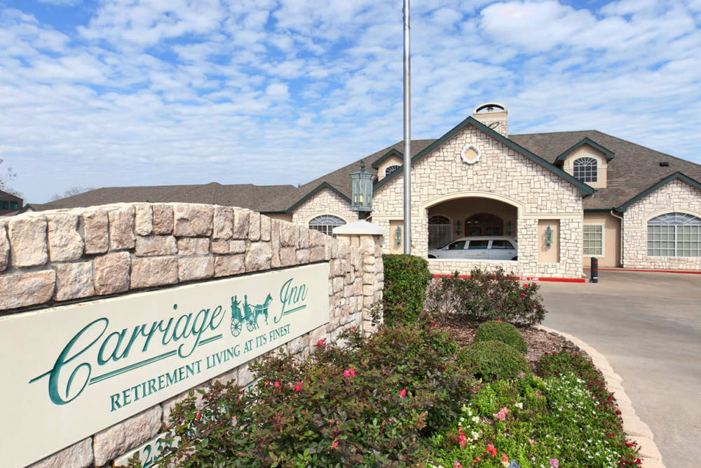 Branding and signage outside of Carriage Inn Bryan in Bryan, Texas