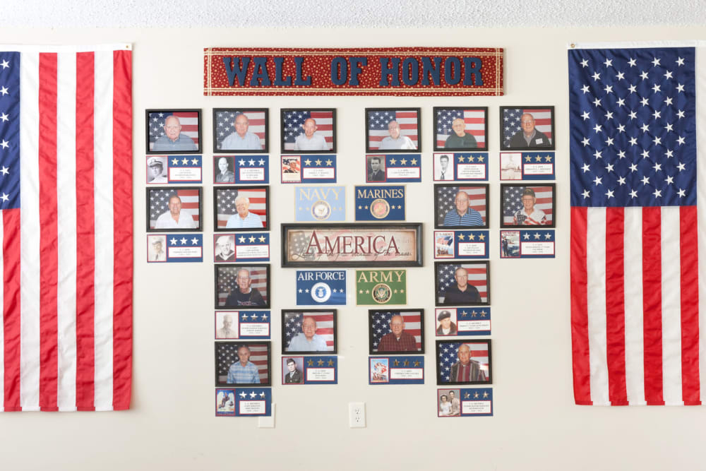 A wall of honor for veteran residents at Carriage Inn Lake Jackson in Lake Jackson, Texas