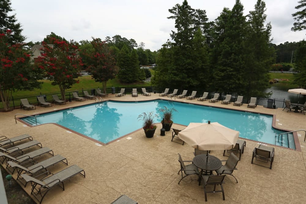 Resident pool with lounge chairs at Broad River Trace in Columbia, South Carolina.