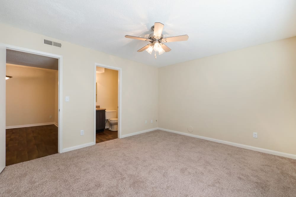 Large bedroom with carpet at The Hills at Oakwood in Chattanooga, Tennessee
