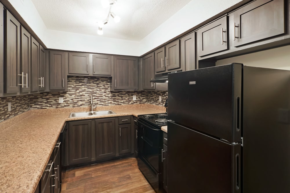 Kitchen with dark cabinets at The Hills at Oakwood in Chattanooga, Tennessee
