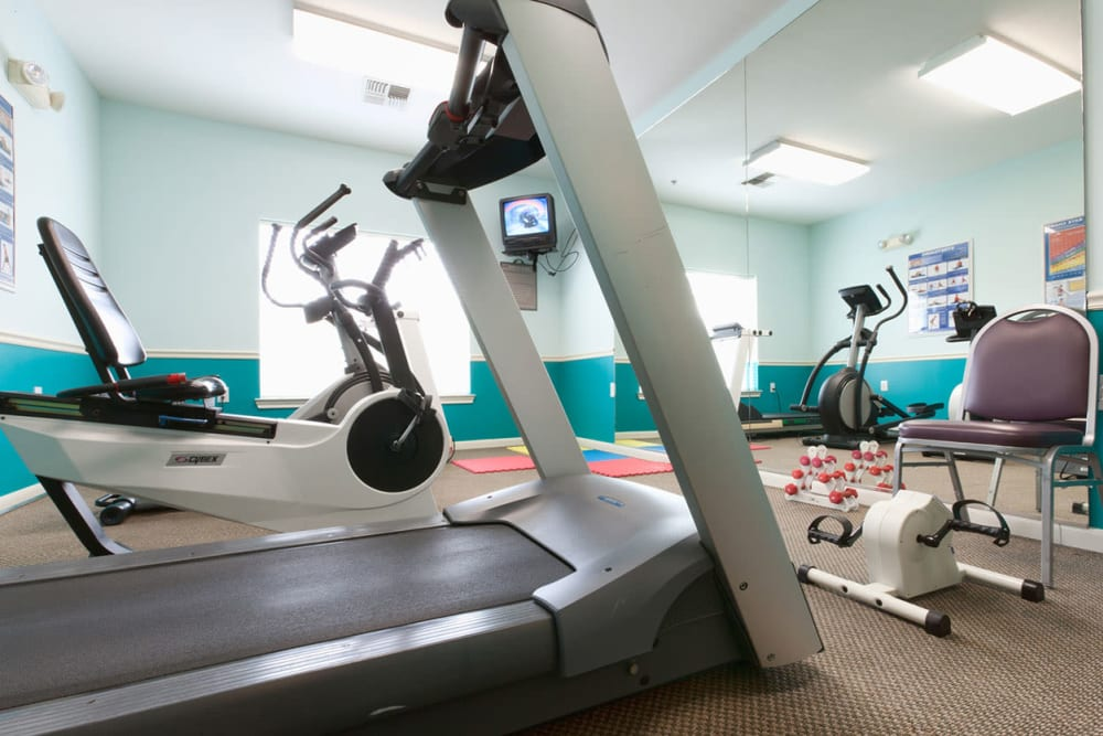 Exercise equipment in the gym at Village on the Park Steeplechase in Houston, Texas