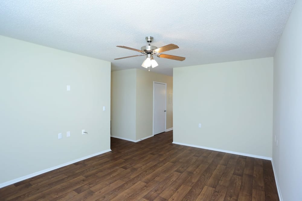 Room with hardwood style flooring at Madison Pines in Madison, Alabama