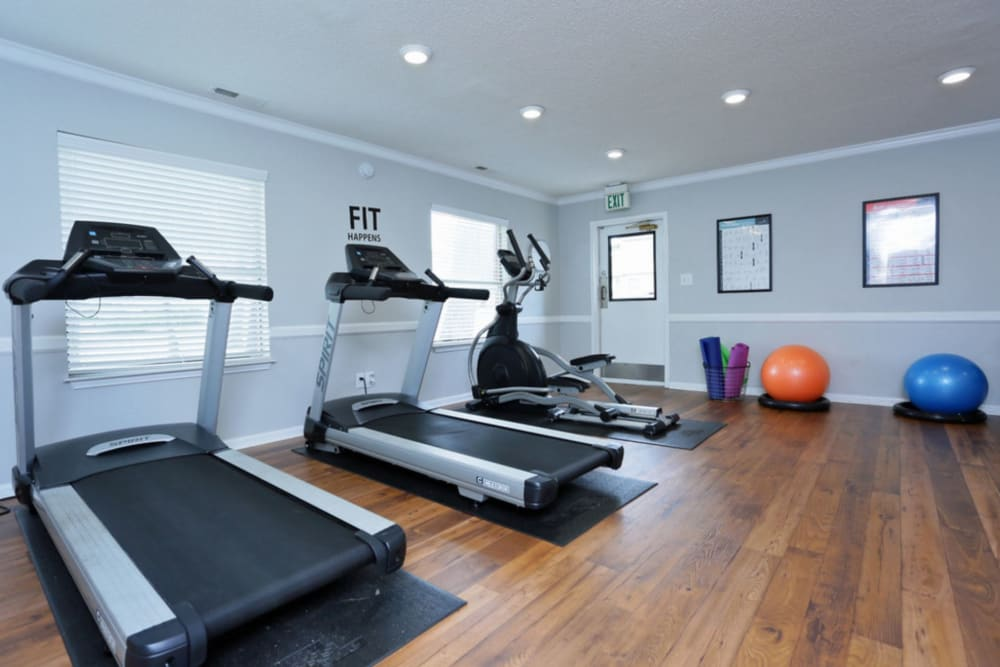 Well lit fitness center at Madison Pines in Madison, Alabama