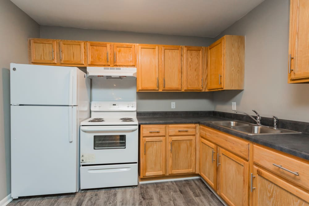 Kitchen with white appliances at Gibson Creek Apartments in Madison, Tennessee