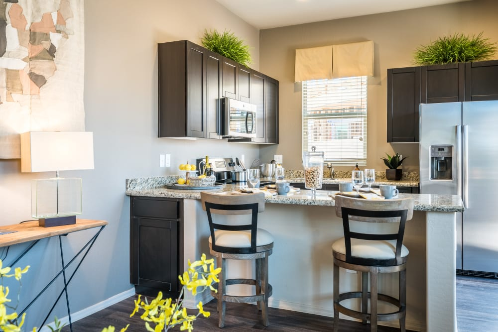 Kitchen with a breakfast bar at Avilla Grace in Chandler AZ