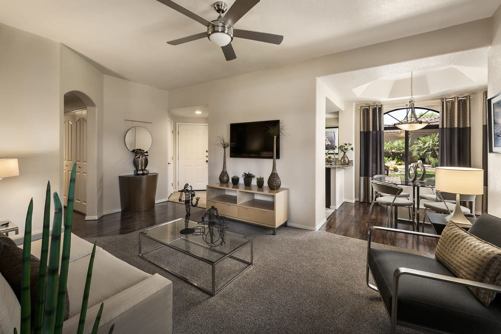 Beautiful open-concept floor plan with wood-style flooring in model home at San Cervantes in Chandler, Arizona