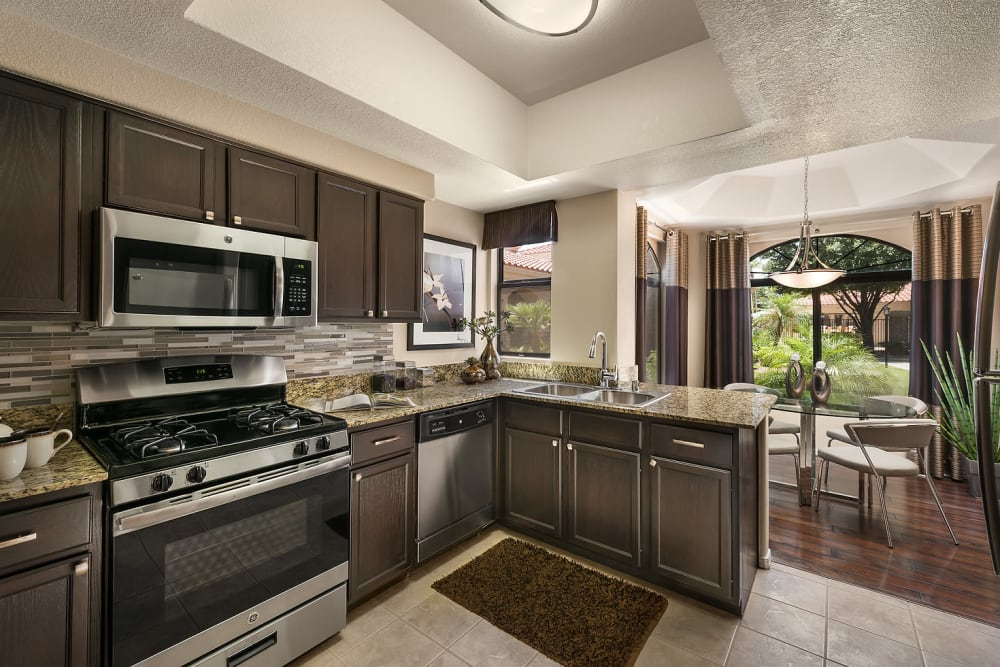 Granite countertops and double stainless-steel sink at San Cervantes in Chandler, Arizona