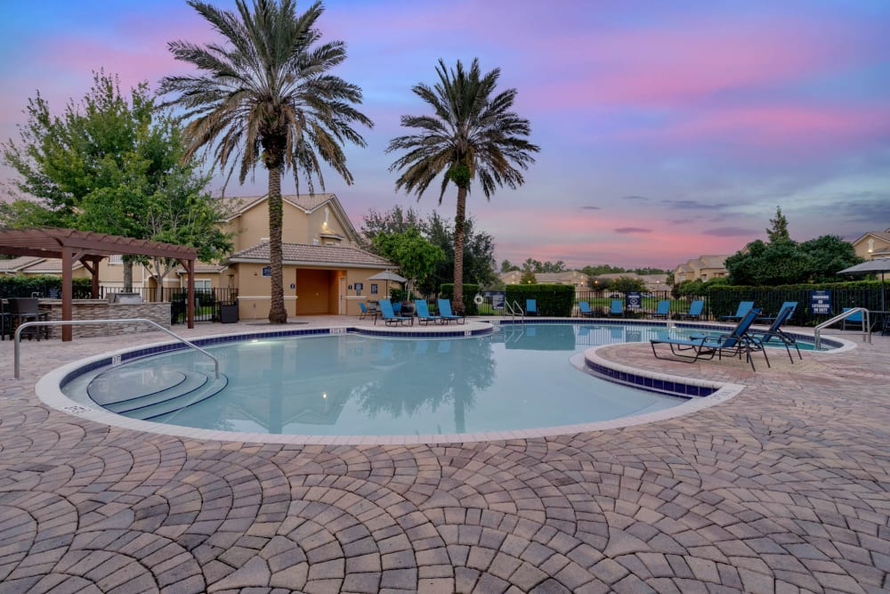 Outdoor pool at dusk at Palms at World Gateway in Orlando, Florida