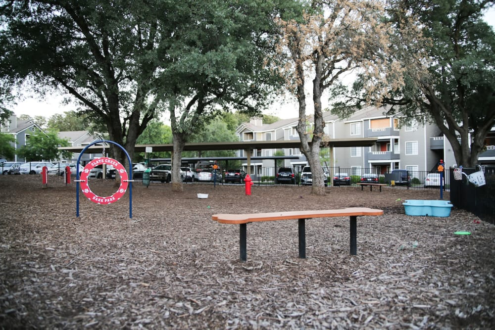 Dog park with agility course at Slate Creek Apartments in Roseville, California