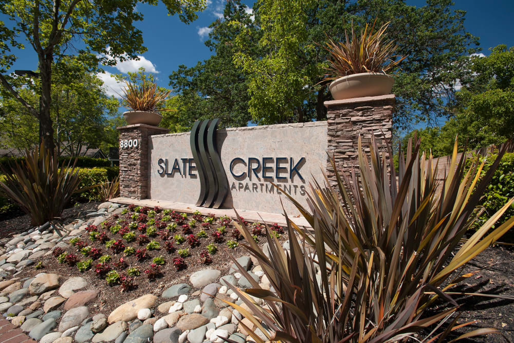 Monument sign outside our community at Slate Creek Apartments in Roseville, California