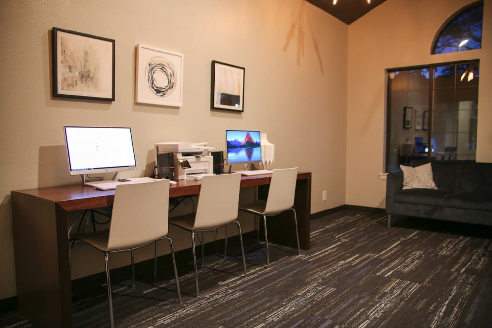 Computers and printers in the business center at Slate Creek Apartments in Roseville, California