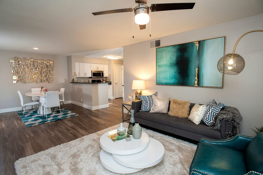 Ceiling fan and modern decor in a model home's living area at Slate Creek Apartments in Roseville, California