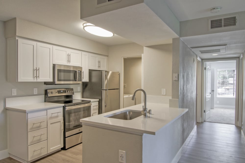 Stainless-steel appliances in a model home's kitchen at Slate Creek Apartments in Roseville, California