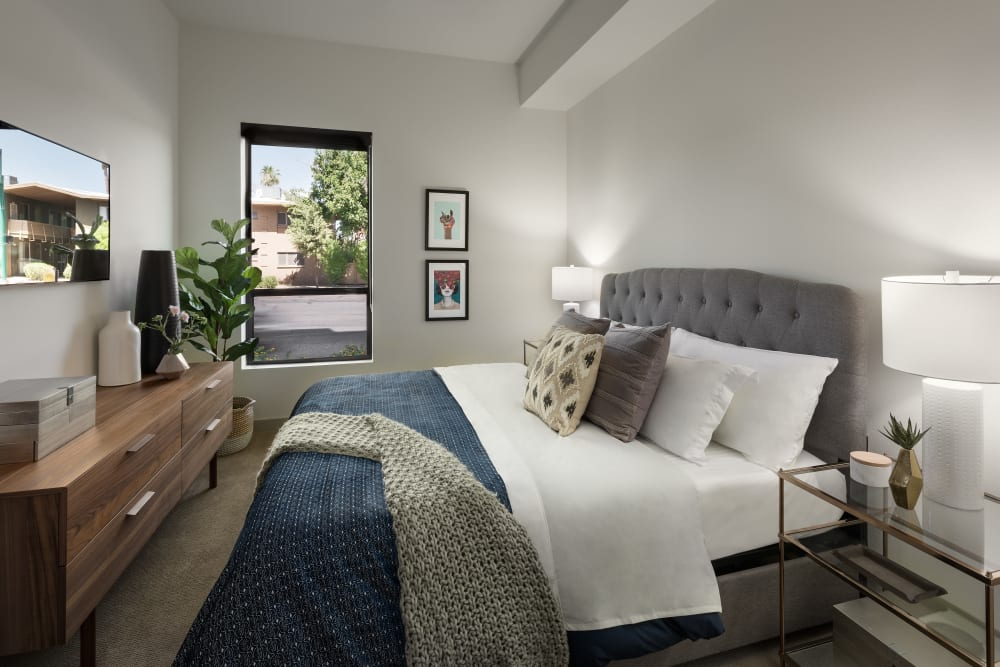 Modern decor in bedroom of model home at The Astor at Osborn in Phoenix, Arizona