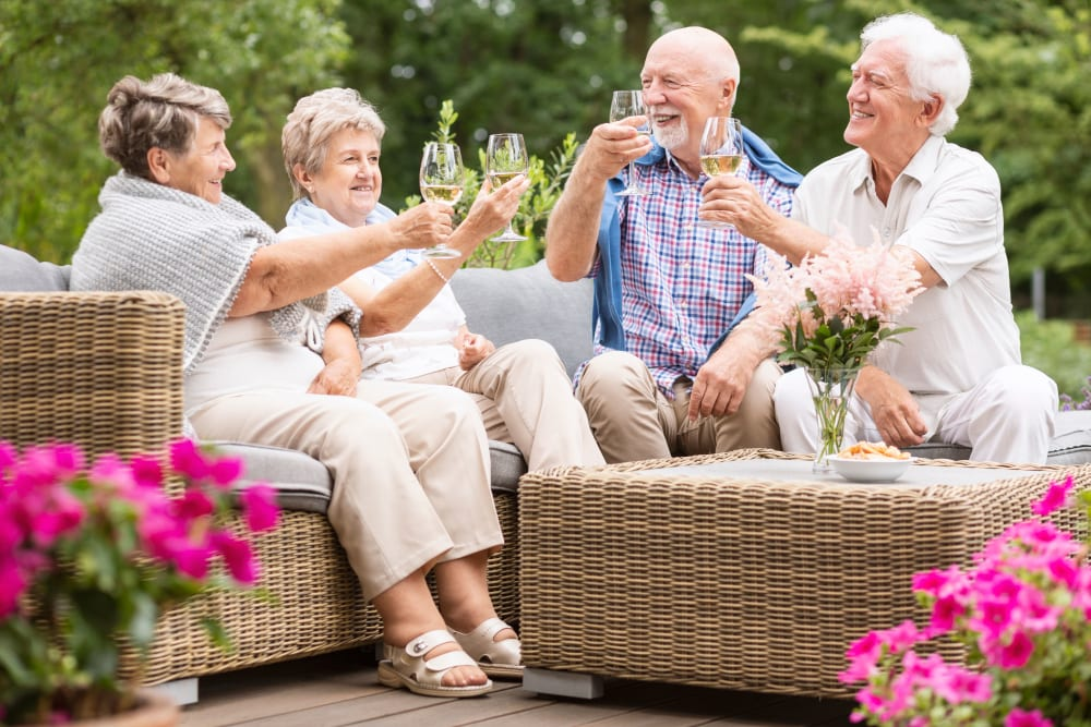 Residents toasting outside of WellQuest of Menifee Lakes in Menifee, California