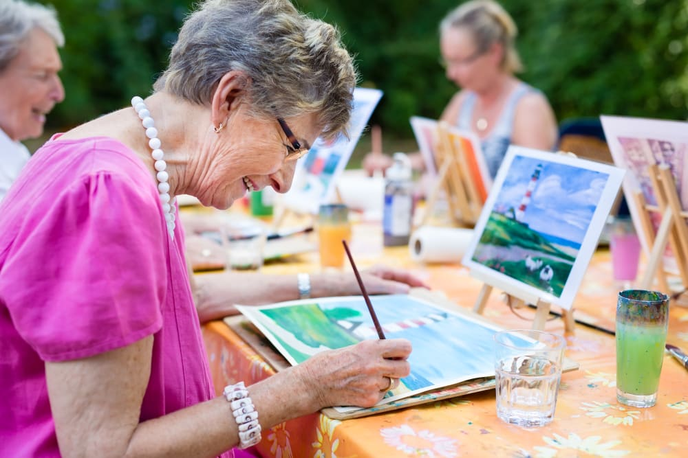 Residents painting for an event at WellQuest of Menifee Lakes in Menifee, California