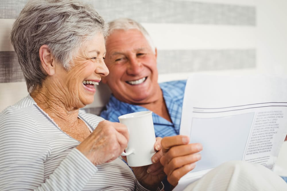 Residents happily reading the newspaper at WellQuest of Granite Bay in Granite Bay, California