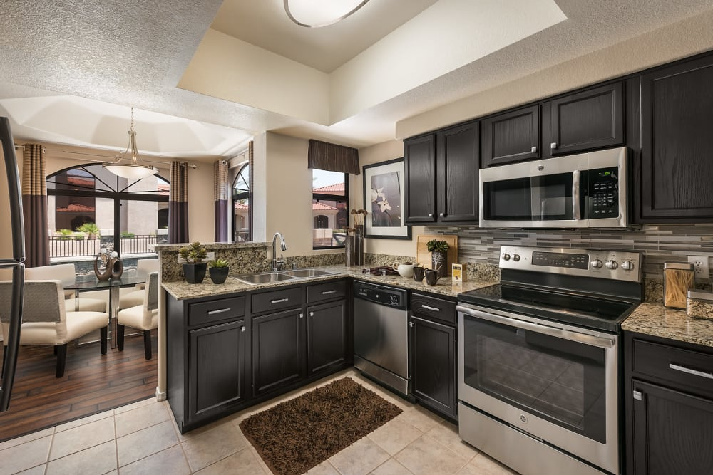 Spacious kitchen with granite counters at San Lagos in Glendale, Arizona
