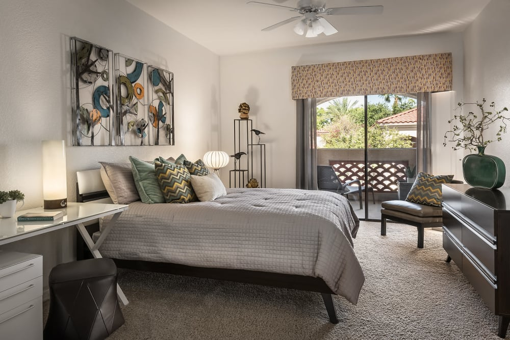 Master bedroom with modern decor at San Lagos in Glendale, Arizona