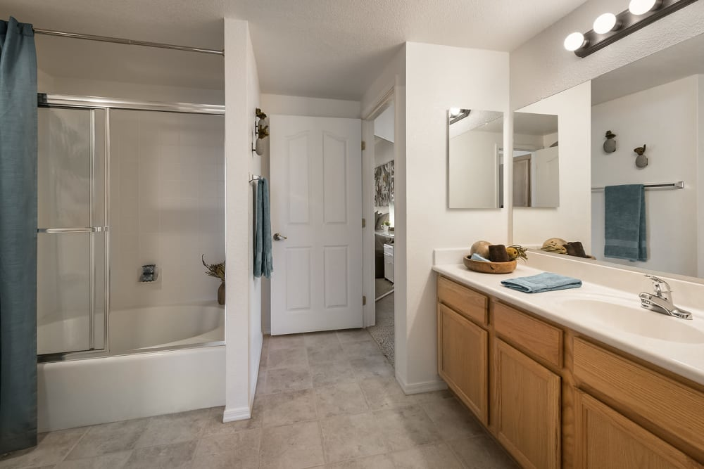 Open and spacious tiled-floor bathroom at San Lagos in Glendale, Arizona