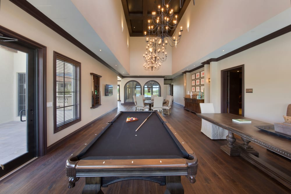 Game room with a billiards table and more in the clubhouse at Doral Station in Miami, Florida