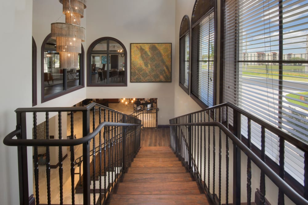 View of the hardwood stairs leading down from the upper floor of the resident clubhouse at Doral Station in Miami, Florida