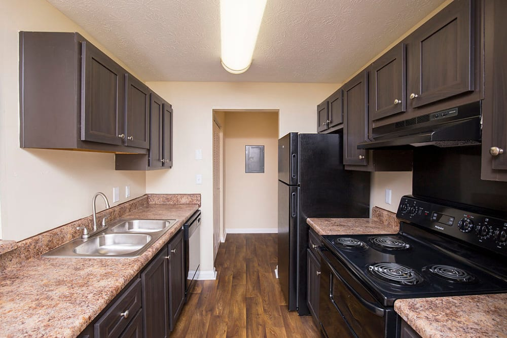 Kitchen with hard wood flooring at The Greens at Cascade in Atlanta, Georgia