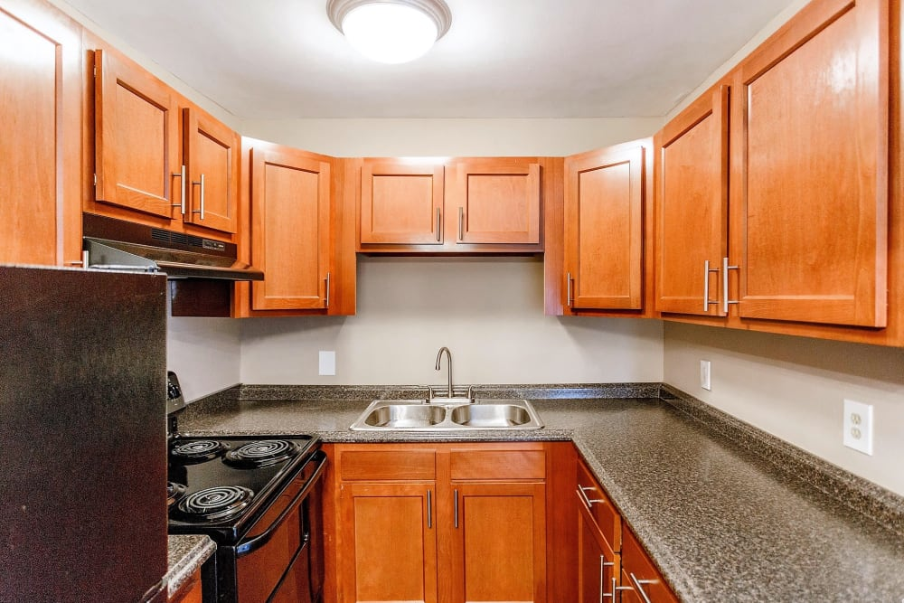 Kitchen with wood style cabinets at Maple Creek in Nashville Tennessee