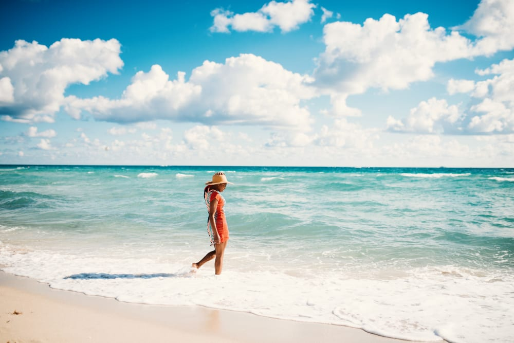 New resident enjoying the beach near Amara at MetroWest in Orlando, Florida
