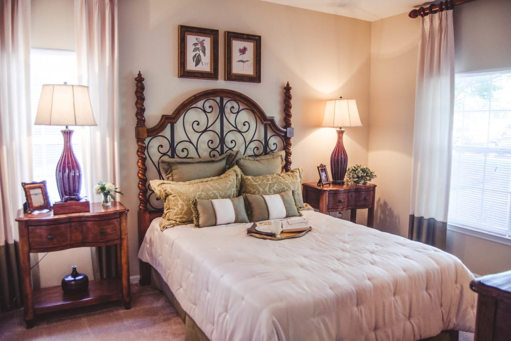 Well-lit bedroom at Lullwater at Saluda Pointe in Lexington, South Carolina
