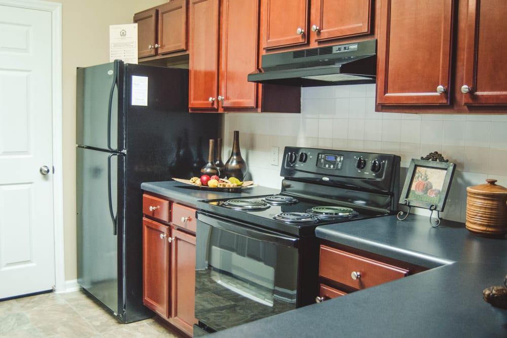 Kitchen with black appliances at Lullwater at Saluda Pointe in Lexington, South Carolina