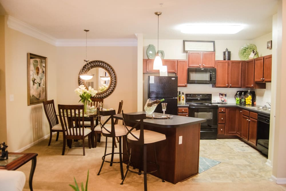 Kitchen with bar style seating at Lullwater at Saluda Pointe in Lexington, South Carolina