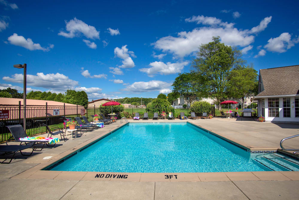 Resident pool with sundeck at 1820 South Apartments in Mount Pleasant, Michigan.