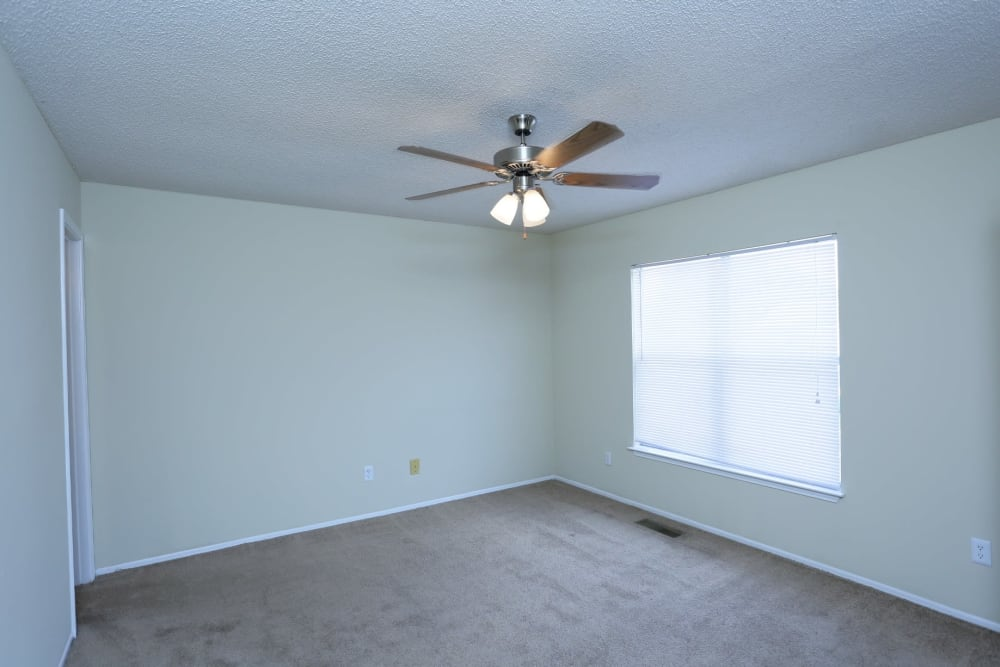 Large room with ceiling fan at Madison Pines in Madison, Alabama